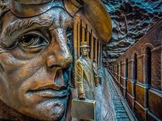 Going Underground (bronze frieze panel, St Pancras Station) by Jim Strom