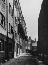 Now demolished street in Hebden Bridge. Darkroom print by John Woodhead